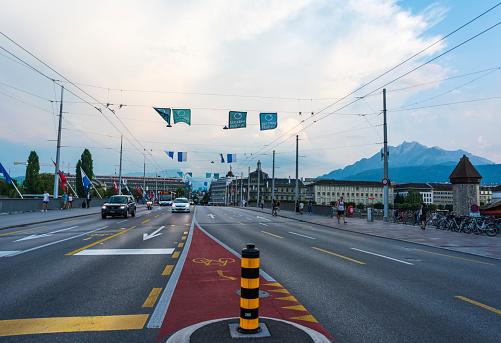 Mont Blanc bridge and Swiss flags on road in Geneva, Switzerland