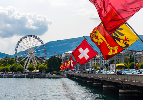Mont Blanc Bridge and Swiss flags with ferris wheel Geneva in Switzerland