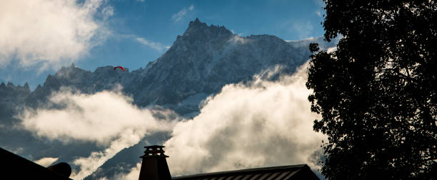 Mont Blanc Towering over the chimney of a house stock photo