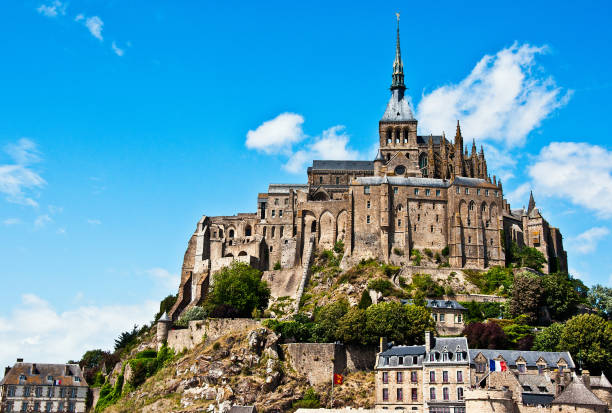 Mont Saint Michel A view of the monastery at Mont St Michel in Normandy, France. manche stock pictures, royalty-free photos & images