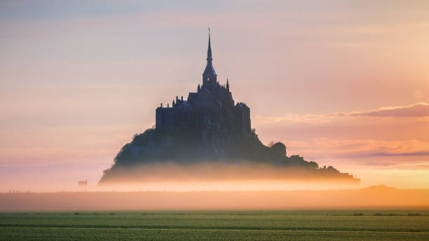 Mont Saint-Michel view in the sunrise light. Normandy, northern France Mont Saint-Michel view in the sunrise light. Normandy, northern France manche stock pictures, royalty-free photos & images