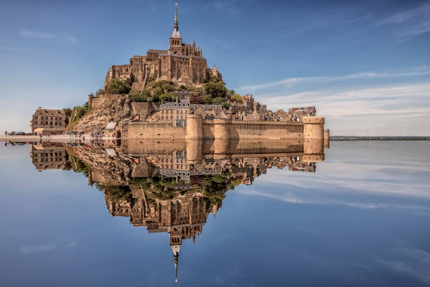 Mont St Michel in daytime Mont Saint Michel, an UNESCO world heritage site in Normandy, France manche stock pictures, royalty-free photos & images
