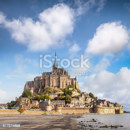 Mont St Michel, Normandy, France, on a bright summer day. It is France's most visited provincial tourist attraction, and is often claimed by Brittany as it's very close to the border.