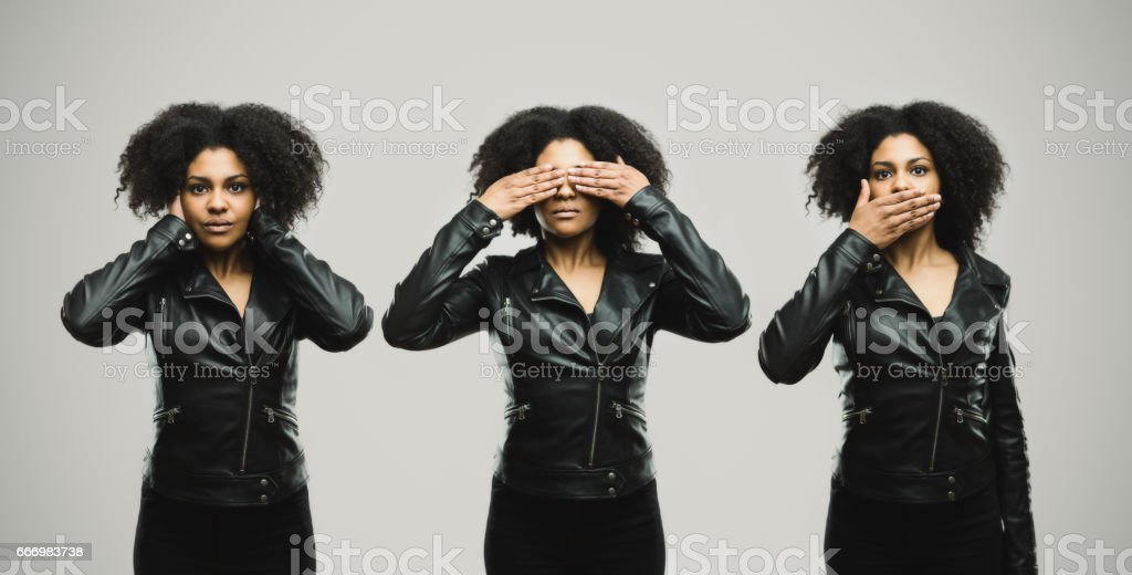 Montage of a real woman covering her eye, ears and mouth stock photo