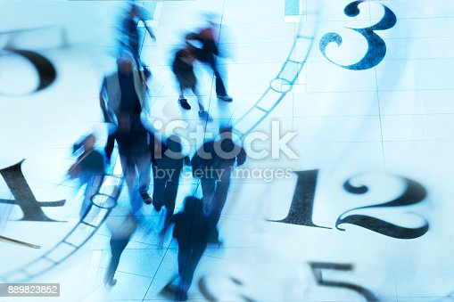 A montage of blurred pedestrians walking and a multitude of clock faces.