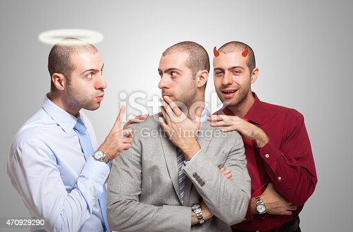 Man listening to the angel and devil self to make a choice