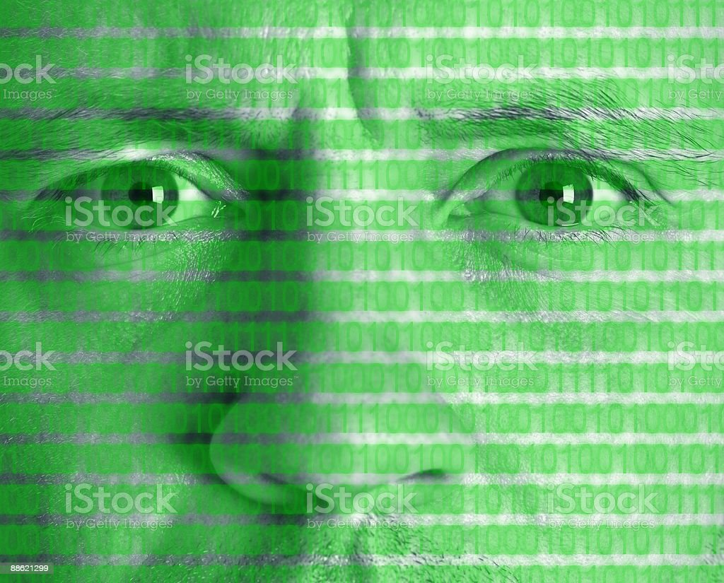 Montage of mans face with binary code royalty-free stock photo
