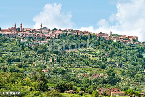948424058istockphoto Montalcino skyline and Italy Val D'Orcia countryside in Tuscany hilltop small town village cityscape in summer green trees 1138184998