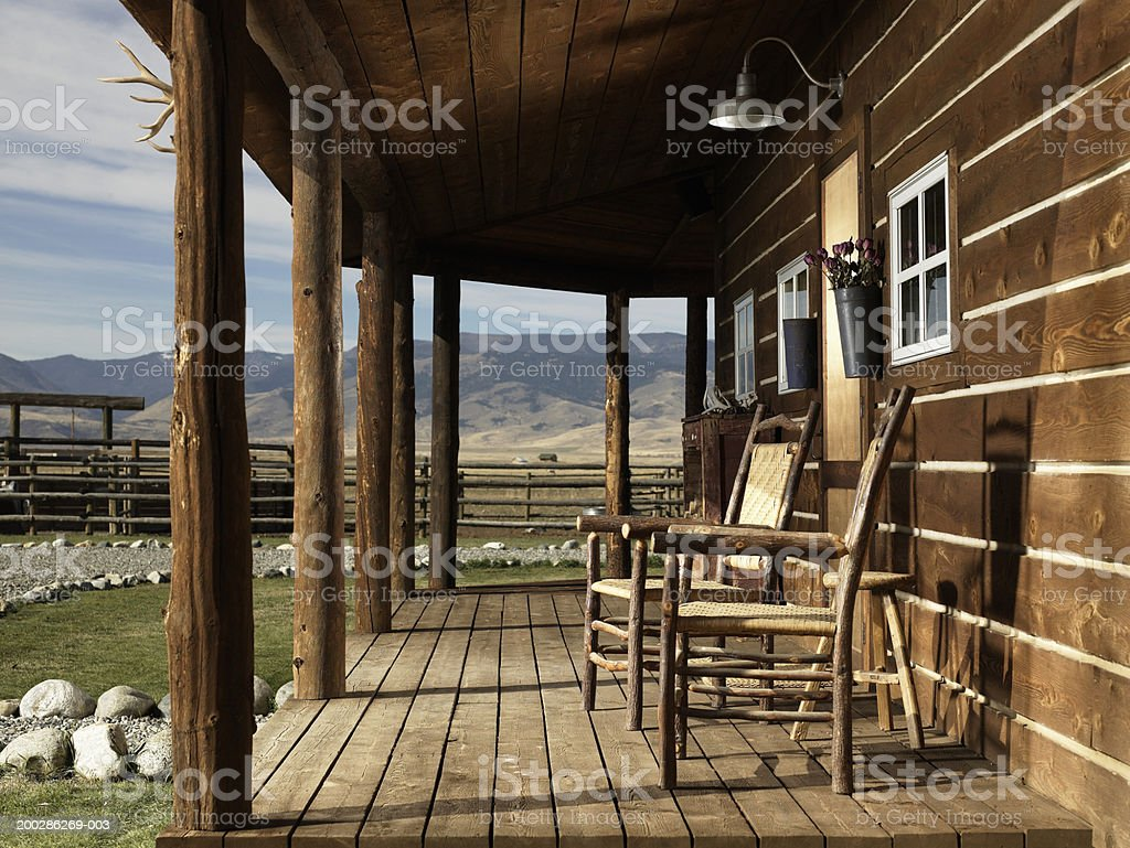 USA, Montana, Bozeman, chairs on porch of cabin stock photo