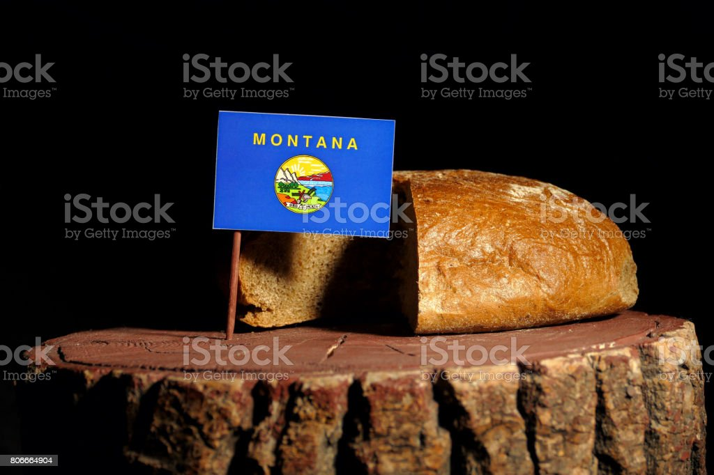 Bandeira de Montana em um toco com pão isolado - foto de acervo