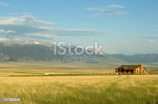 Ranch house with mountains on background in Montana, USA
