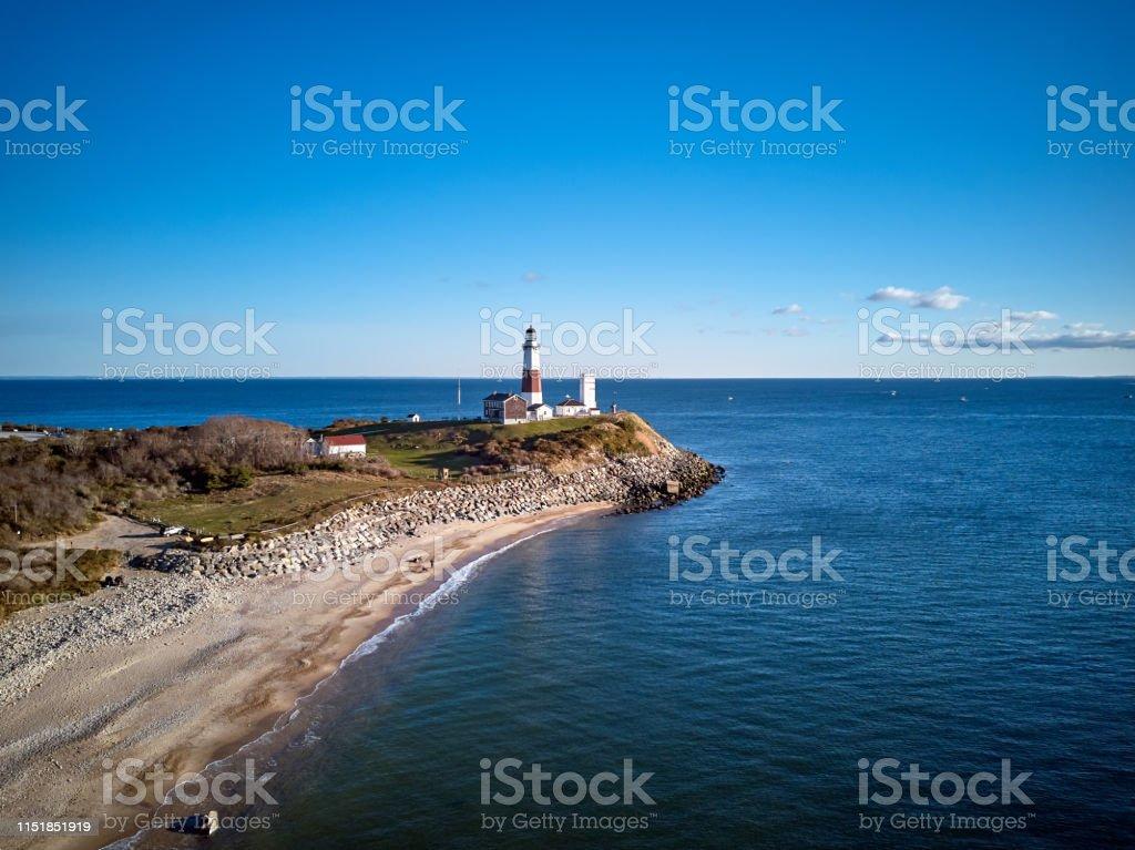 Montauk Lighthouse and beach aerial shot Montauk Lighthouse and beach aerial shot, Long Island, New York, USA. Beach Stock Photo