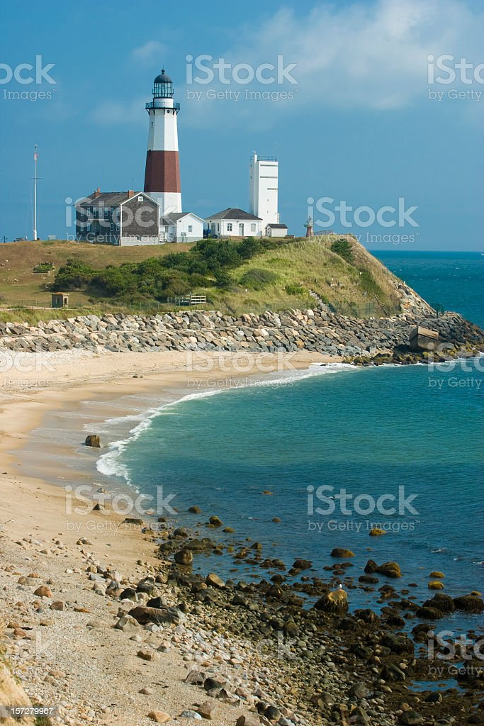 Montauk Lighthouse beside a beautiful beach stock photo