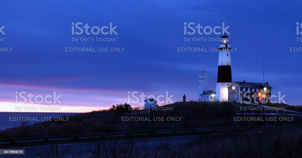 Montauk Point Lighthouse at Dawn Rich Blue Sky stock photo