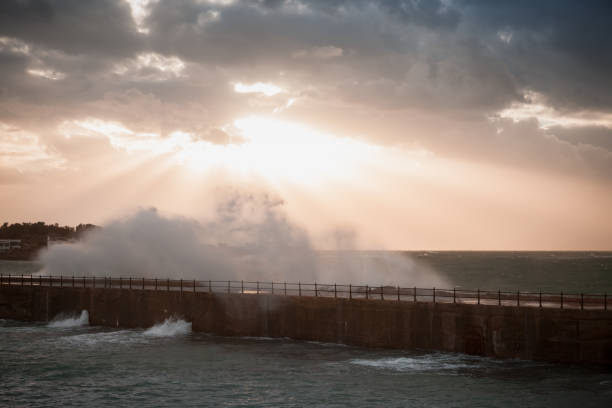 Montazah beach. Dramatic landscape with big waves Montazah beach. Dramatic landscape with big stormy waves under evening cloudy sky. Alexandria, Egypt groyne stock pictures, royalty-free photos & images