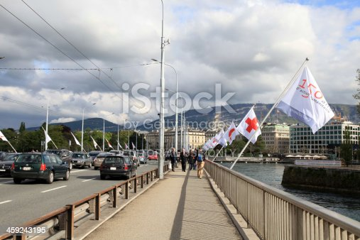 Geneva , Switzerland - May 10, 2013: Mont-Blanc bridge (Pont du Mont-Blanc) is the main bridge in Geneva , Switzerland at May 10, 2013 .