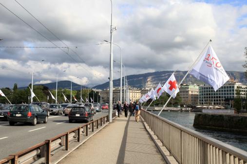 Geneva , Switzerland - May 10, 2013: Mont-Blanc bridge (Pont du Mont-Blanc) is the main bridge in Geneva , Switzerland at May 10, 2013 .