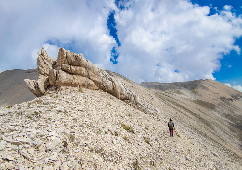 Monte Amaro, Italy - 12 September 2021 - The mountain summit in the Majella range, central Italy, Abruzzo region, with characteristic landscape of rocky expanses between valleys and plateaus. Here a view of summit