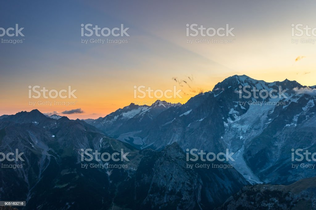 Monte Bianco sunset Mont Blanc summit (4810 m) and his melting glaciers. View from 3000 m in Valle d'Aosta. Summer adventures on the italian french Alps. stock photo