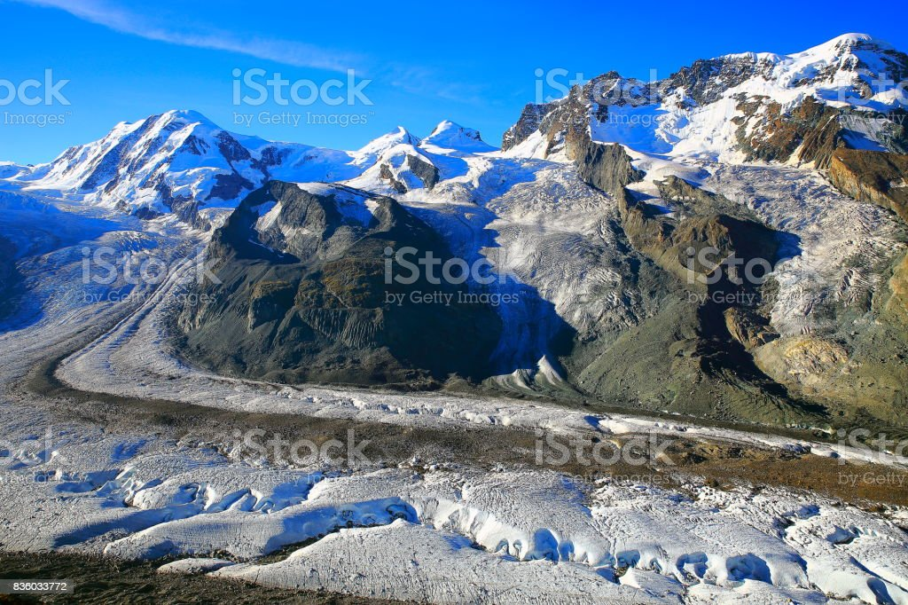 Monte Rosa massif Fairy tale landscape: above idyllic Zermatt Gorner glacier crevasses moraine valley and white snowy ice from Gornergrat, dramatic swiss snowcapped alps, idyllic countryside, Valais, Swiss Alps, Switzerland stock photo