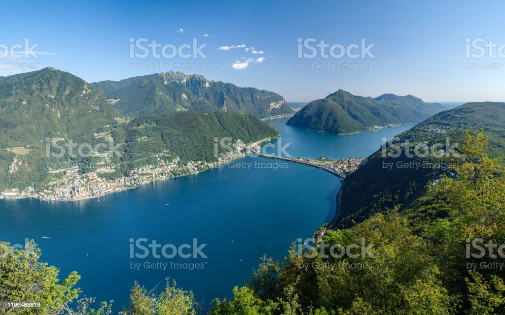 Monte San Salvatore, Lugano, Switzerland, August 03, 2019 - Panoramic view on the Lugano lake from panoramic viewpoint in San Salvatore (912 m) - Стоковые фото Lake Lugano роялти-фри