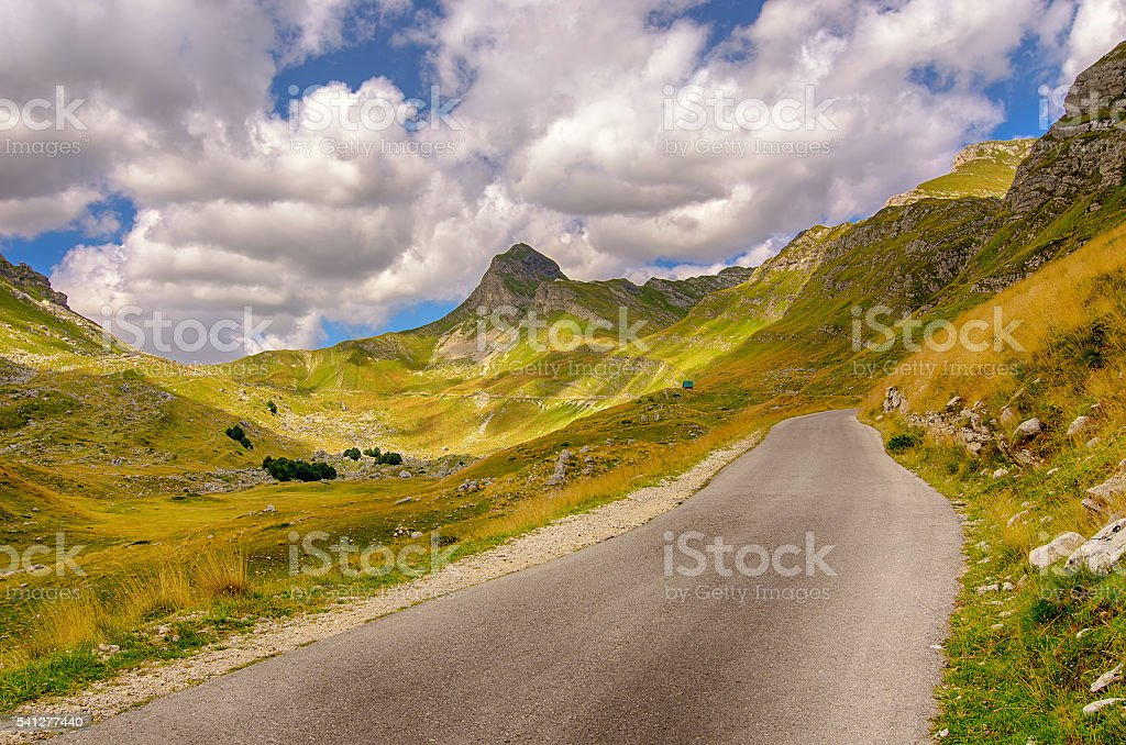 Montenegro, national park Durmitor, road,mountains and clouds. stock photo