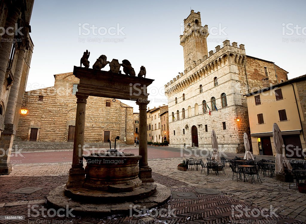 Montepulciano Square with Well and Town Hall Tower stock photo