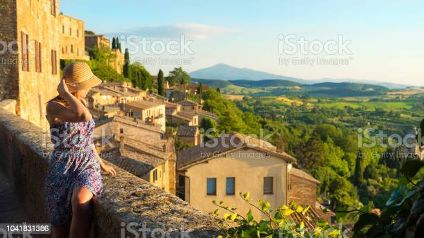 Montepulciano tuscany italy girl looks at the landscape of the city picture id1041831386?b=1&k=6&m=1041831386&s=612x612&h=q rc m5e5bmhnvpwom0obgobtsl4amx1x2jkt  gz7g=