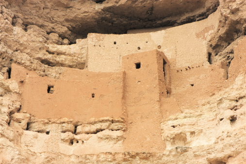 Montezuma Castle National Monument Native American adobe cliff dwelling in Arizona Southwest desert.  The pueblo structure was used by Hohokam and Sinaguan cultures providing protection and access to fertile land and water.