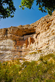 Montezuma Castle is a well-preserved adobe cliff dwelling in Camp Verde Arizona. It was used by the Sinagua and Hohokam people between approximately 1100 and 1425 AD. Tourists now visit this site often to see how Native American cultures lived.