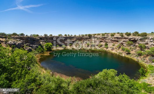 Montezuma Well is part of Montezuma Castle National Monument in Arizona, USA. Ancient cliff dwelling is visible on the left side of the photograph.