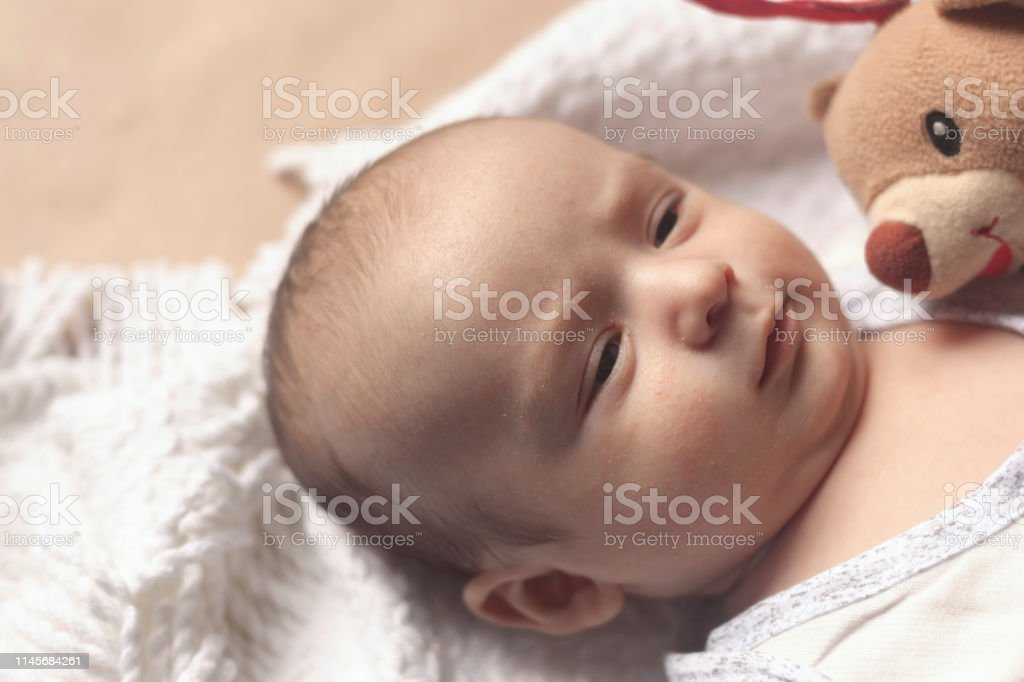 2 Month Baby Boy Lying Closeup Of Adorable Cute Newborn Baby Boy Of Two Months On Soft Textile Lovely Child Playing With Plush Toy Stock Photo Download Image Now Istock