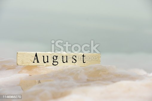 istock month in wooden blocks Against the backdrop of the Dead Sea 1146965270