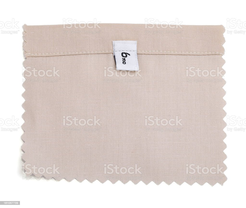 6 Month Labeled Beige Fabric Swatch royalty-free stock photo