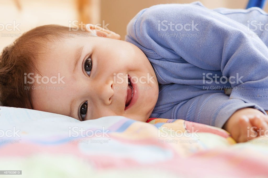 cd7fc2d7f82c 7 Month Old Baby Girl On Blanket Smiling To Viewer Stock Photo ...