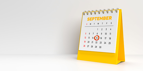 Special days concept: Important holidays and events marked in red on a white and yellow monthly desktop calendar for 2021. A modern reminder to prepare for that extra day. White background with large blank space for additional text message.