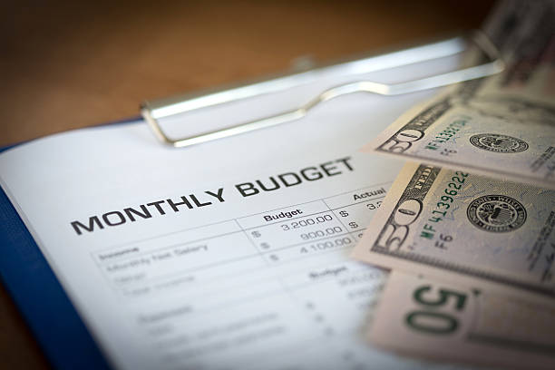 monthly budget plan for expenses and money - home finances stock pictures, royalty-free photos & images