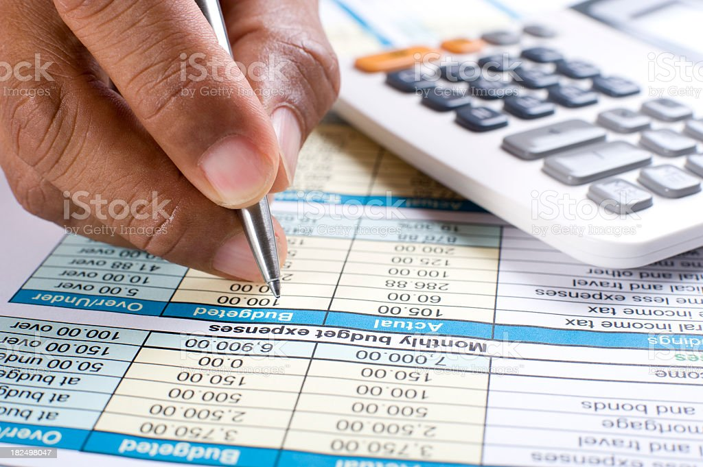 Monthly budget with calculator royalty-free stock photo