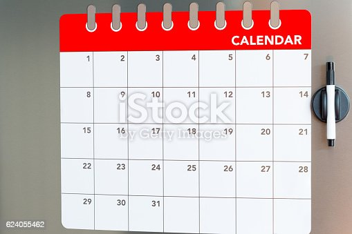 istock Monthly calendar in the fridge 624055462