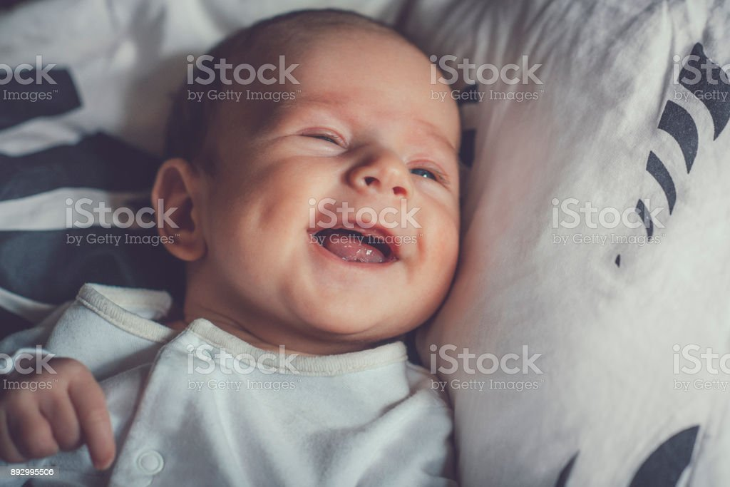 2 months baby laughing stock photo