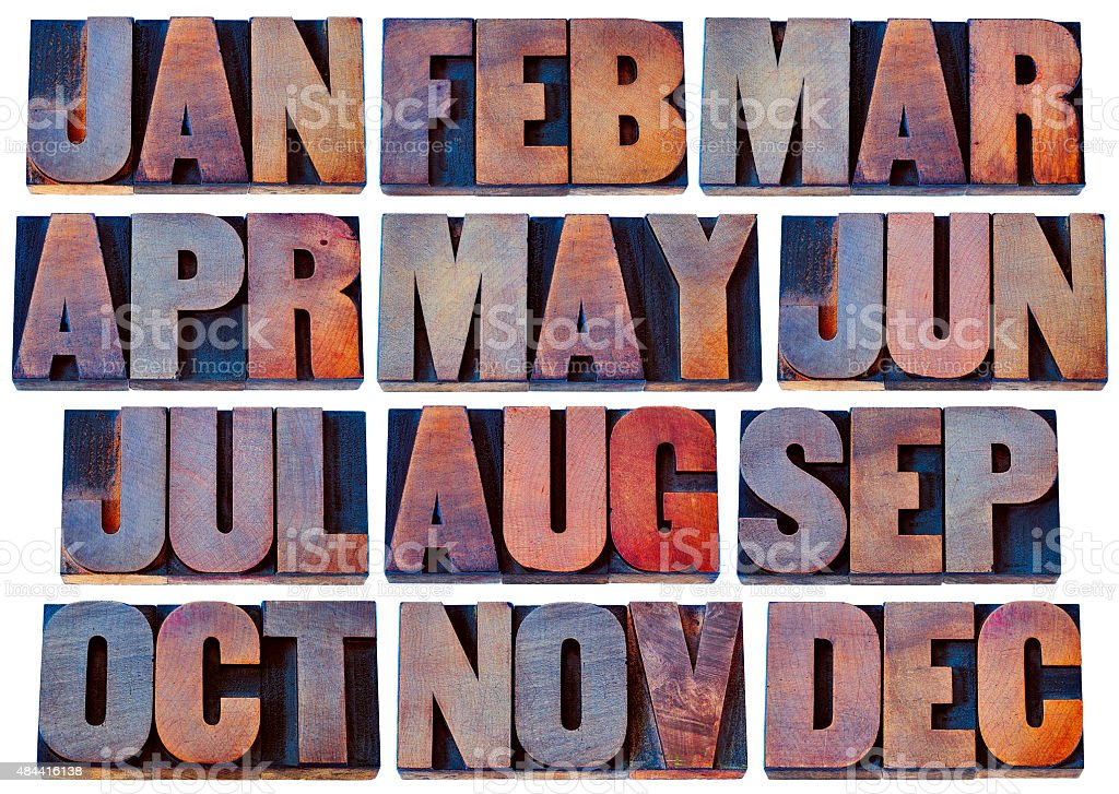 months in wood type - calendar concept stock photo