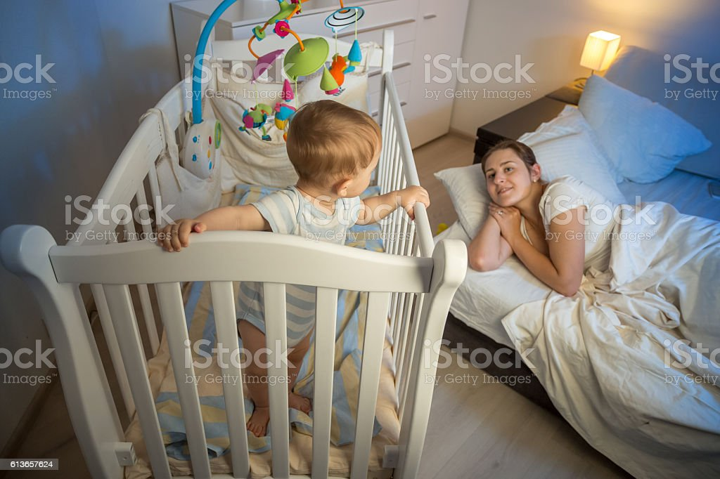 Adult baby in crib