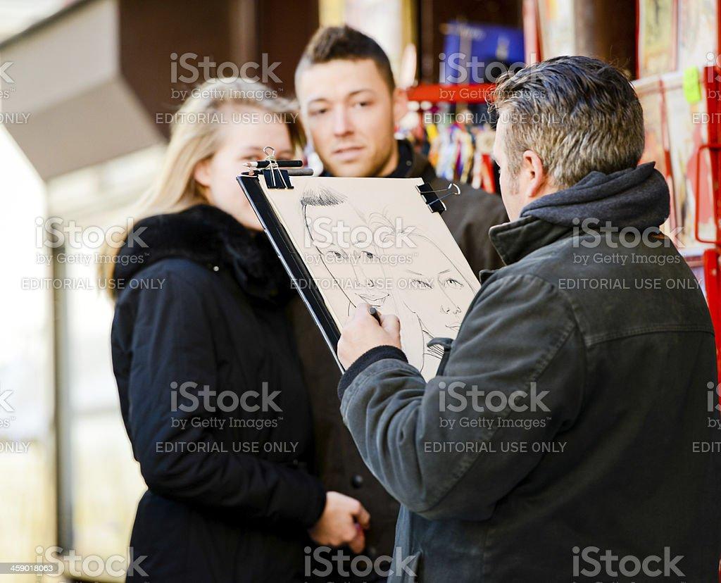 Montmartre Artist painting Portrait of couple, Paris royalty-free stock photo