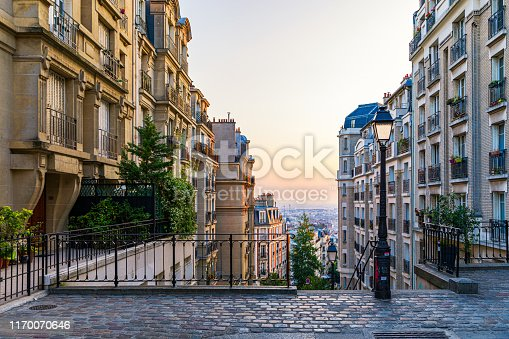 istock Montmartre district of Paris. Morning Montmartre staircase in Paris, France. Europa. View of cozy street in quarter Montmartre in Paris, France. Architecture and landmarks of Paris. Postcard of Paris. 1170070646
