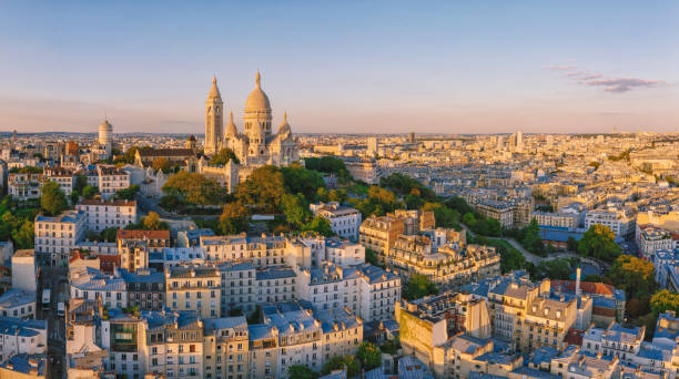 Montmartre hill with Basilique du Sacre-Coeur in Paris at sunset, aerial view stock photo