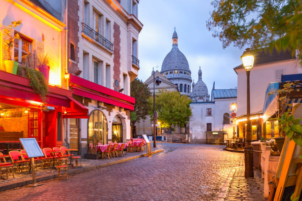 Montmartre in Paris, France The Place du Tertre with tables of cafe and the Sacre-Coeur in the morning, quarter Montmartre in Paris, France french culture stock pictures, royalty-free photos & images