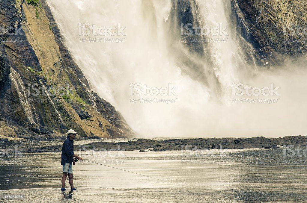 Montmorency Falls, Fishing, Fisherman, Quebec City, Canada. stock photo