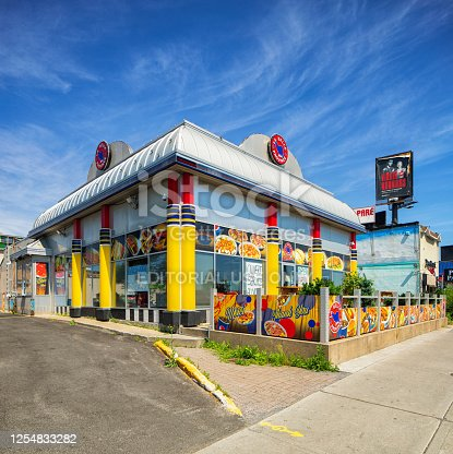 Montreal Belle Province colorful deli restaurant with cool architecture. They serve classical fast food Quebecois fare such as Poutine, burgers, smoked meat sandwiches and great French Fries.