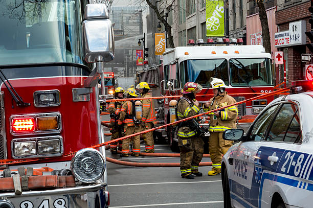 Montreal Firefighters on Street at Historic Heritage Building Fire stock photo