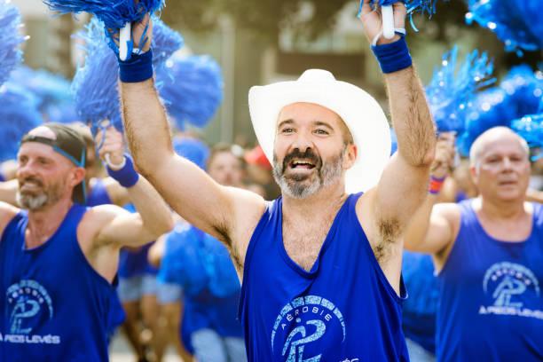 Montreal gay pride parade group of aerobic fitness men cheering stock photo